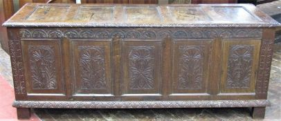 A substantial Georgian oak coffer with repeating geometric detail, within a panelled framework,