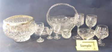 A large collection of cut glass to include goblets, decanters, bowls, together with a small