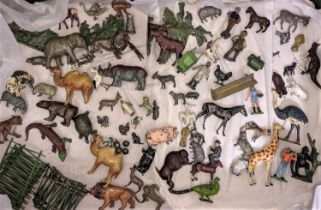 A box of lead painted toys, many by Britains including farm and zoo animals, people, tools, fencing,