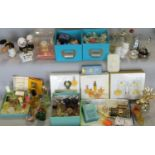 Collection of miniature perfume bottles with and without contents, including novelty shapes and a