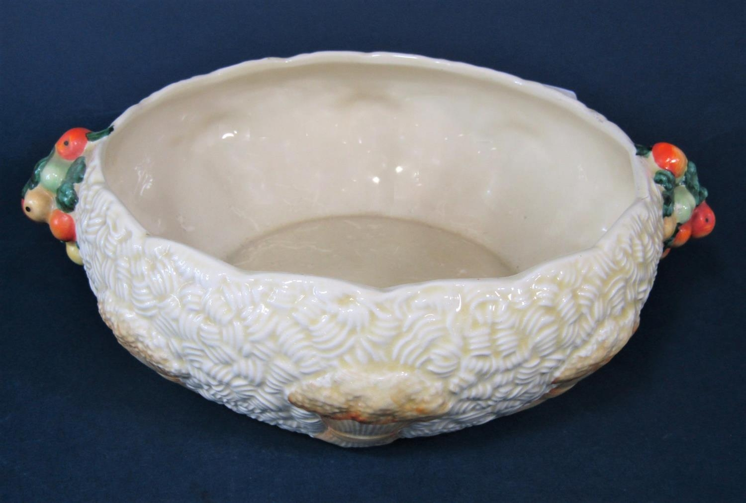 A Clarice Cliff relief moulded bowl in the Celtic Harvest pattern with moulded fruit handles and