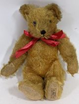 Small 1930's teddy bear 'A Farnell Alpha toy' with golden plush fur and jointed body, pronounced