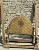 A gilt wood single bedstead the arched and scrolled headboard with repeating scale design and