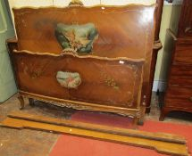 """A continental walnut veneered bedstead with painted detail, 144cm wide (to accept 4' 6"""" mattress)"""