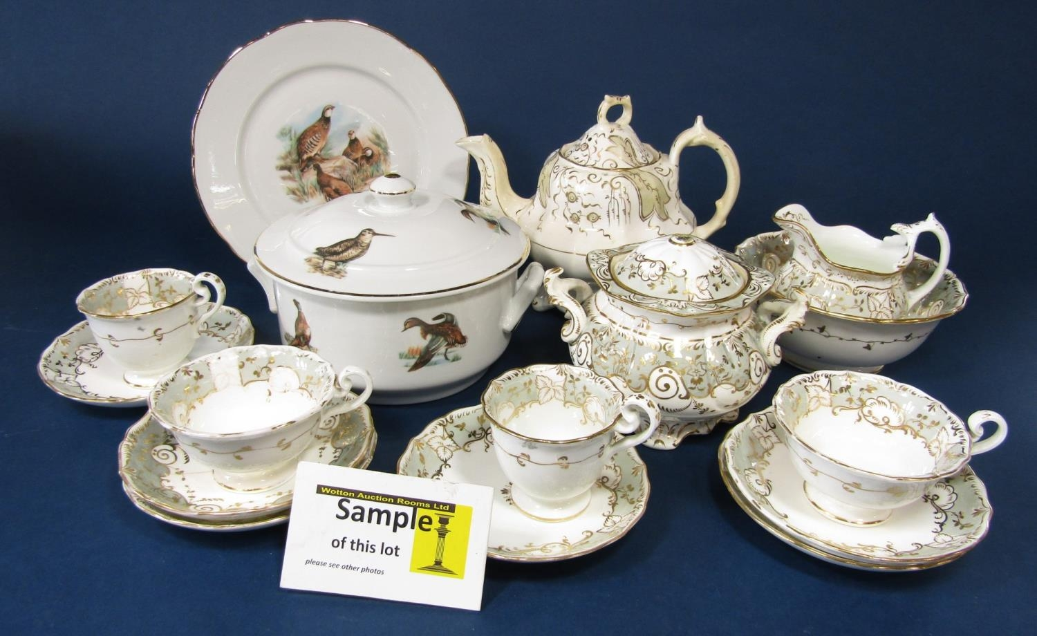 A quantity of Victorian tea wares with grey and gilt border decoration including a pair of covered