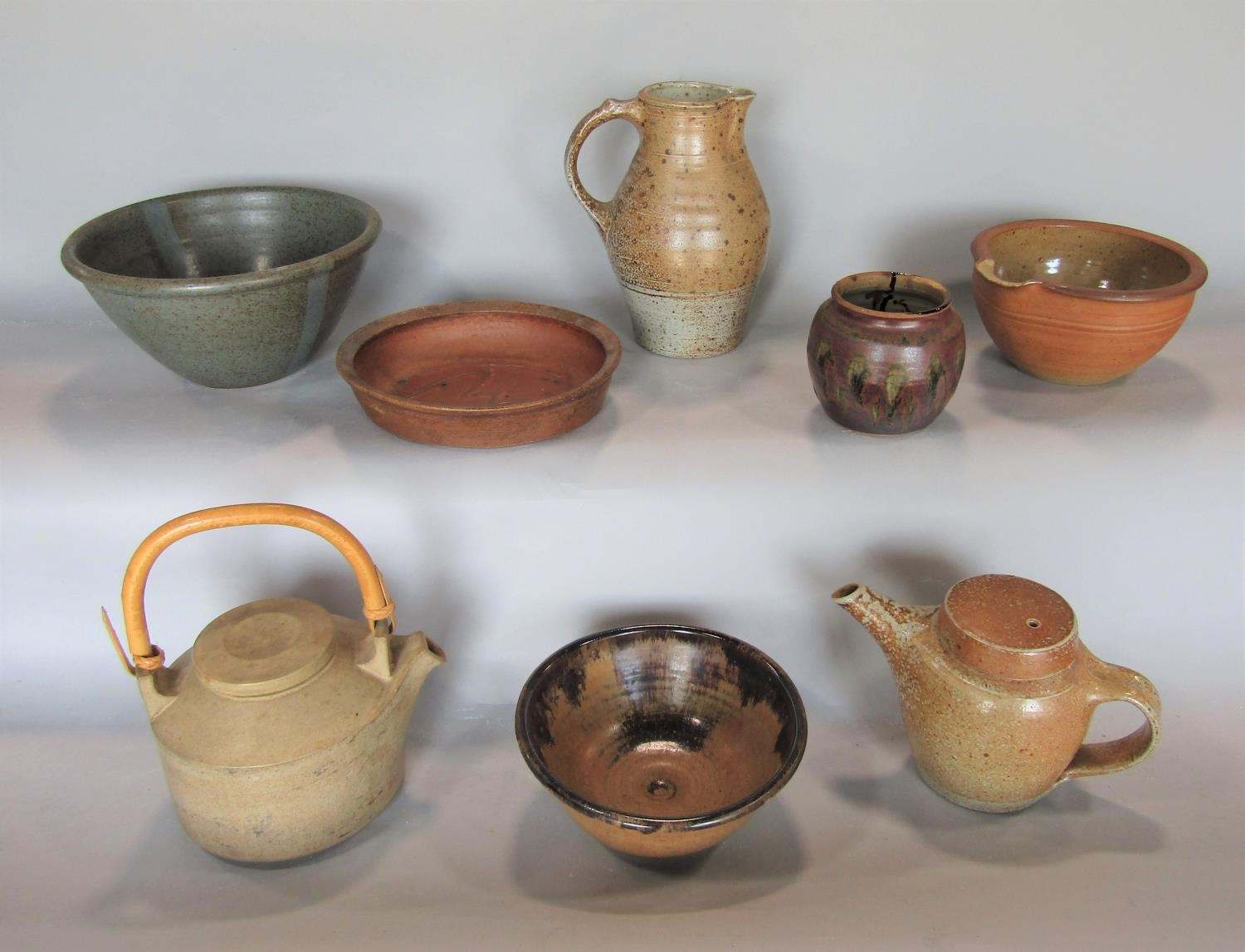 A collection of Studio pottery ware including teapot, bowls, etc by Winchcombe pottery and others