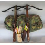 2 rifle cross bows together with a camouflage bag containing items of military uniform