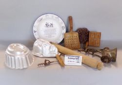 A collection of various vintage kitchenalia comprising marble boards, wooden rolling pins, enamel