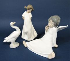 A Lladro Daisa figure of a seated angel, together with a Lladro figure of a goose and a Nao figure