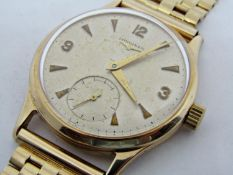 Vintage gent's 9ct Longines dress watch, the champagne dial with gilt baton markers and Arabic