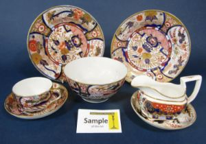 A collection of early 19th century tea and coffee wares with painted and gilded decoration in the
