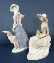 Two Lladro figure groups, one of an elegant lady with a borzoi type dog, 40cm tall approx, the other