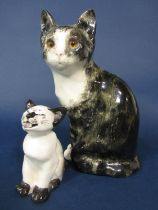 A Winstanley model of a tabby and white seated cat with painted mark to base, 25 cm tall