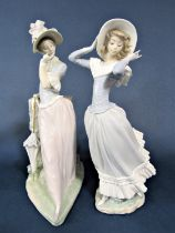 A large Lladro figure of an elegant lady with bonnet and parasol, 38 cm tall approximately, together