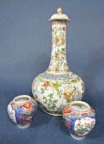 A large 19th century oriental Famille Verte bottle shaped vase and cover with drawn neck, reserve