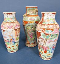 A pair of 19th century Famille Rose vases of shouldered form with painted decoration of garden