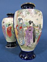 A matched pair of early 20th century oriental vases in the Satsuma manner with painted panels of