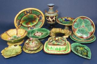 A collection of mainly 19th century majolica wares including a continental two handled vase with