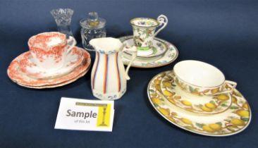 A collection of Foley china teawares with orange printed border decoration comprising milk jug, slop