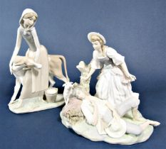 A large Lladro figure group of a milkmaid and calf, 33.5cm tall approx, together with a further