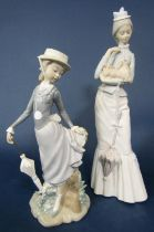 A Lladro figure of a young girl holding a parasol and with her skirt caught on a branch, 28cm tall
