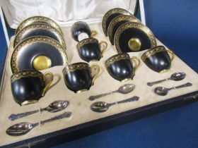 A boxed set of Royal Worcester black ground coffee cups and saucers with enamelled style gilt and