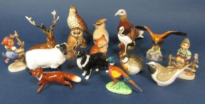 A collection of Beswick and other model animals and birds including a Beswick sheep, sheep dog, fox,