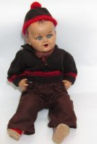 Unusual heavy, vintage character doll with head and bent limbs possibly metal or a hard composition,
