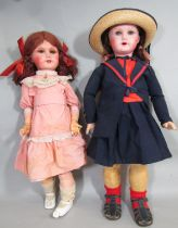 2 early 20th century French dolls both with composition heads, impressed mark 'Paris 301 12',