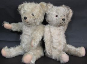 2 faded blue vintage teddy bears, both with jointed body, stitched nose and mouth and felt paw pads.