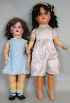 2 early 20th century large composition head dolls, both with closing blue eyes, the taller doll 75cm