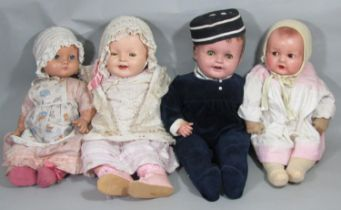 4 composition head character baby dolls including Canadian 'A Reliable Doll' with blue closing eyes,