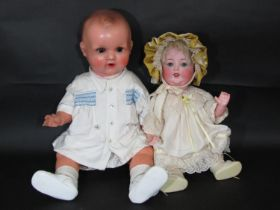 2 Armand Marseille baby dolls both with a 5 piece bent limb composition body, including a bisque