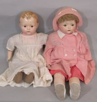 2 large 1920's dolls each with a composition shoulder- head, composition lower limbs and cloth body.