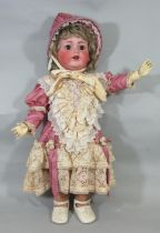 Large bisque head character doll by Kestner with brown closing eyes, open mouth with 2 teeth and