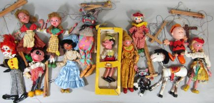 Collection of vintage puppets including boxed Pelham Pinocchio, unboxed cat, mule, clowns, Minnie
