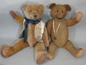 2 large vintage teddy bears, both with a humped back, long snout, long limbs, stitched nose, mouth