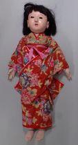 1930's Japanese Gofun Ichimatsu tall doll, originally purchased in Singapore, with glass eyes,
