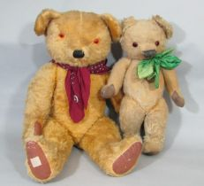 2 mid 20th century teddy bears by Chad Valley, both with glass eyes and stitched noses, the larger