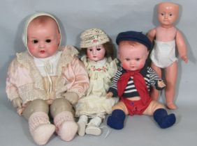 4 bisque head dolls for restoration including an early 20th century doll (no eyes) with open mouth