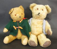 2 vintage teddy bears both with glass eyes, stitched nose and firmly stuffed, jointed bodies.
