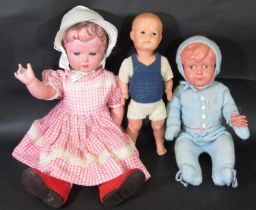 3 early celluloid dolls, the largest, 1930's, is 71cm tall has the turtle mark for Rheinische