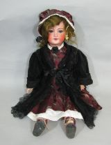 Bisque head doll made by SFBJ with jointed composition body, closing blue eyes, open mouth with 4