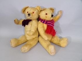 Large vintage teddy bear possibly by Chad Valley with jointed body, stitched nose and mouth, glass