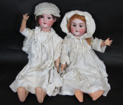 2 early 20th century German bisque head dolls; the taller doll 67cm has head by Armand Marseille,