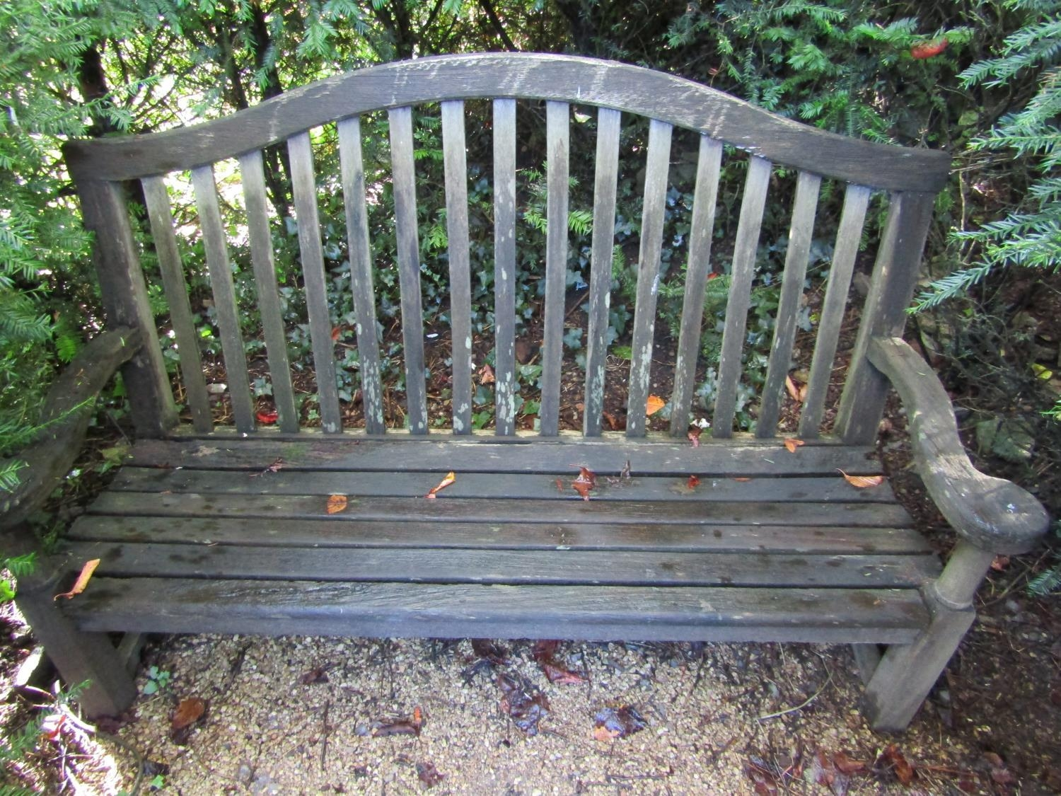 A weathered teak wood garden bench, with scrolled arms and slatted back, 100cm wide - Image 2 of 2