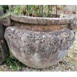 Pair of re-constituted stone urns with scrolled handles