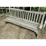 A weathered teak wood garden bench, to commemorate the 1977 Silver Jubilee, 180cm wide