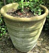 A weathered garden planter of tapering ribbed form (af) 70cm high
