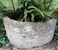 An ancient limestone D end trough, 85cm deep x 95cm wide x 45cm high approx
